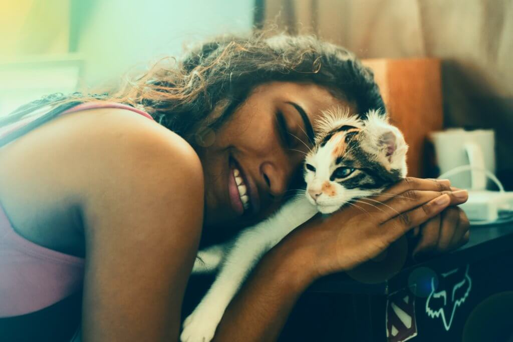 black_women_petting_her_cat.jpeg